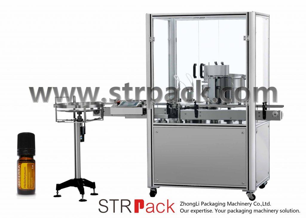 Essentsõli täitekorgi pressimismasin